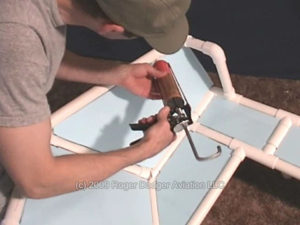 man applying glue to a frame