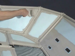 man painting the flight sim enclosure