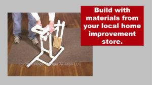 man assembling a pipe frame