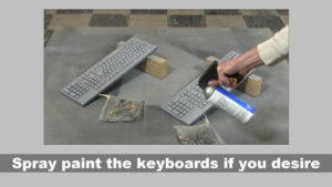spray painting two keyboards