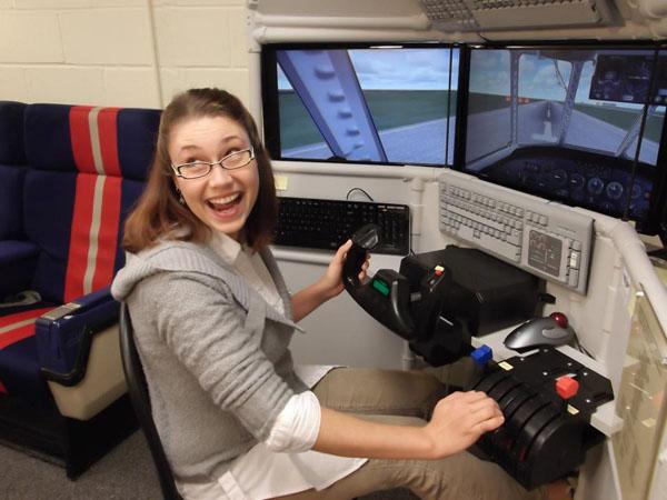 woman flying a three screen flight simulator