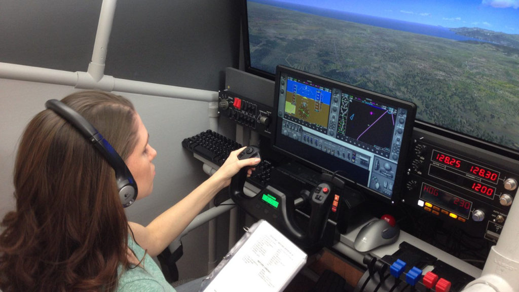 female pilot in flight simulator pod