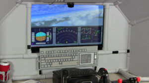at the controls of a flight simulator