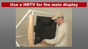 man installing large screen