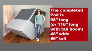 woman standing next to flight sim