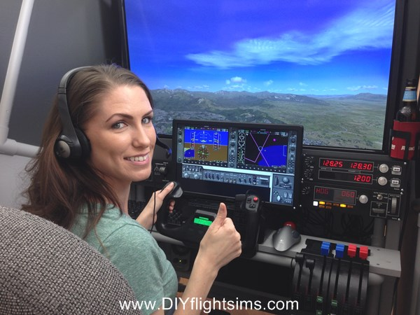 Krystal flying the enclosed flight simulator Pod